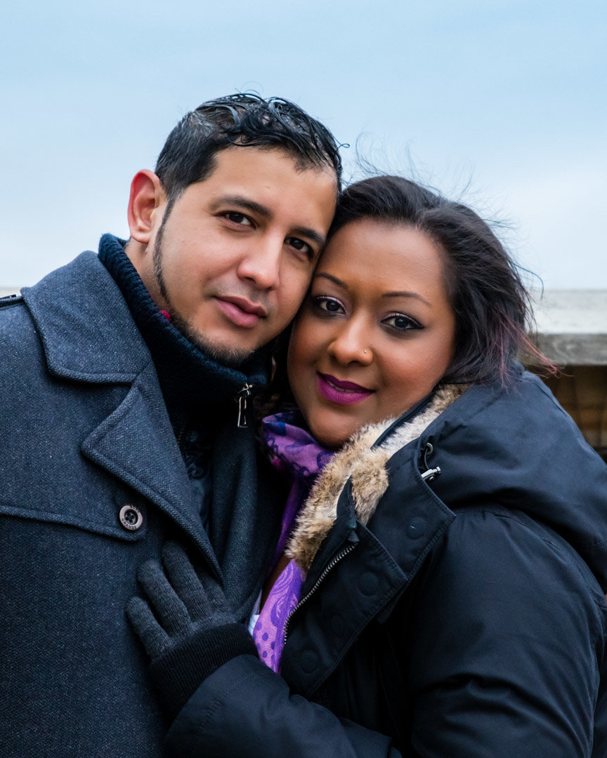 Cute West Indian Couple snuggles close cheek to cheek for a lifestyle photo at Chinguacousy Park in Brampton