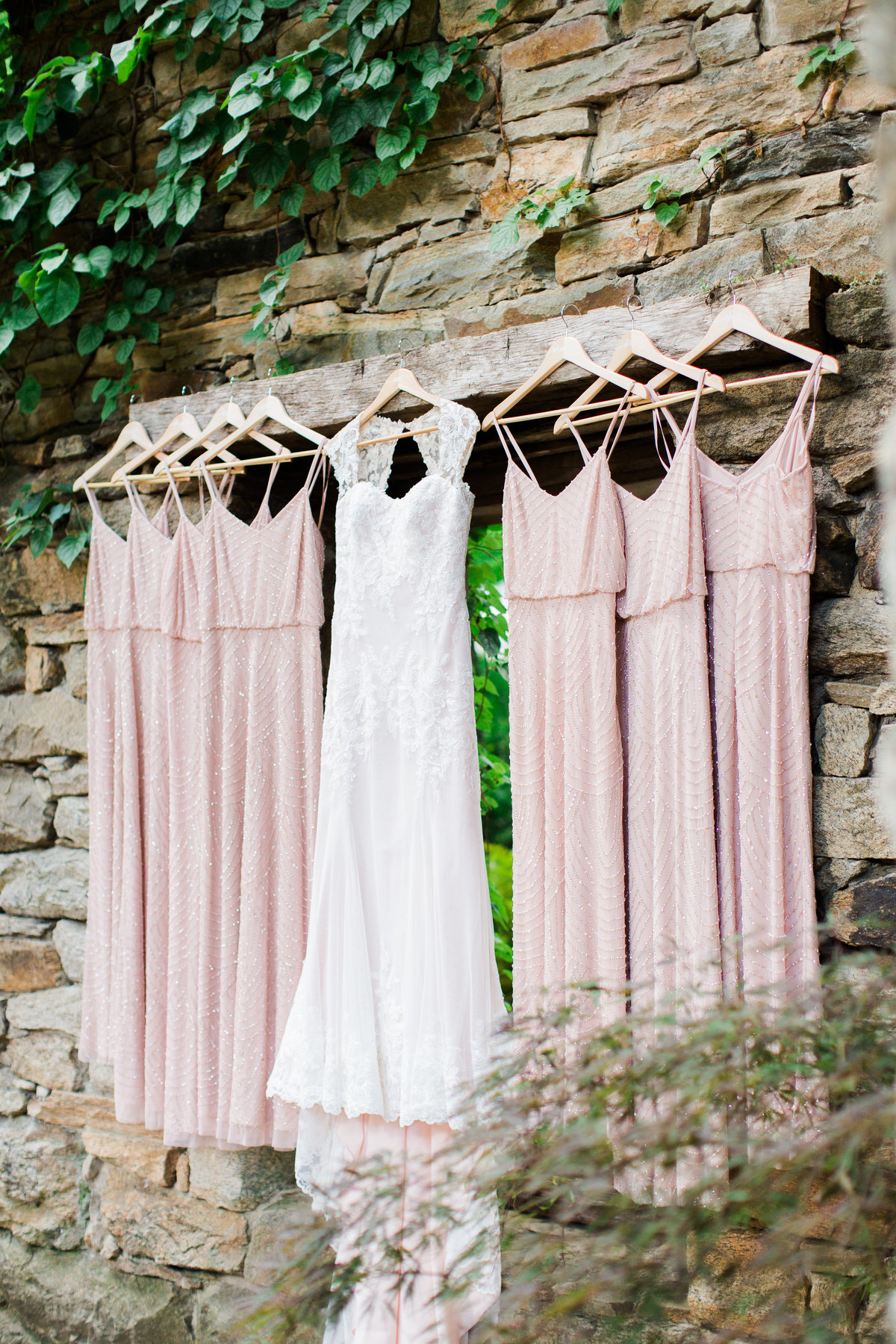 gown hanging on stone wall