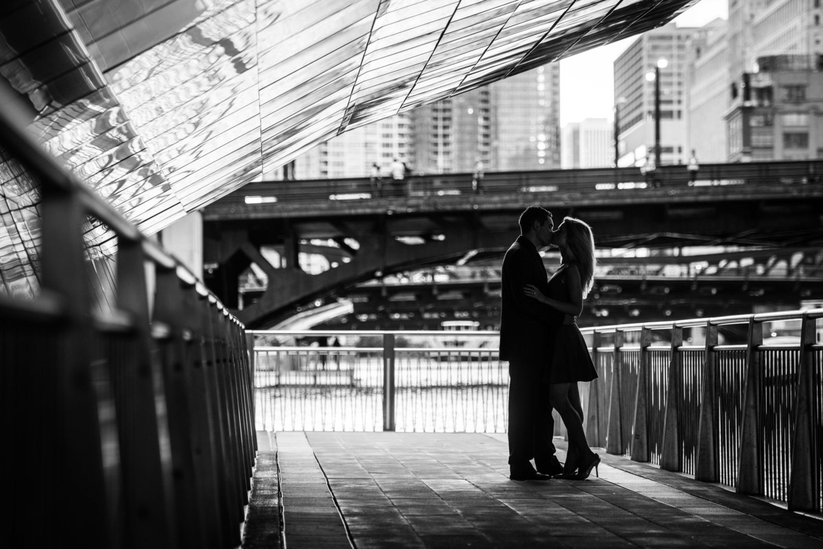 Chicago IL Riverwalk, couple kissing in silhouette.