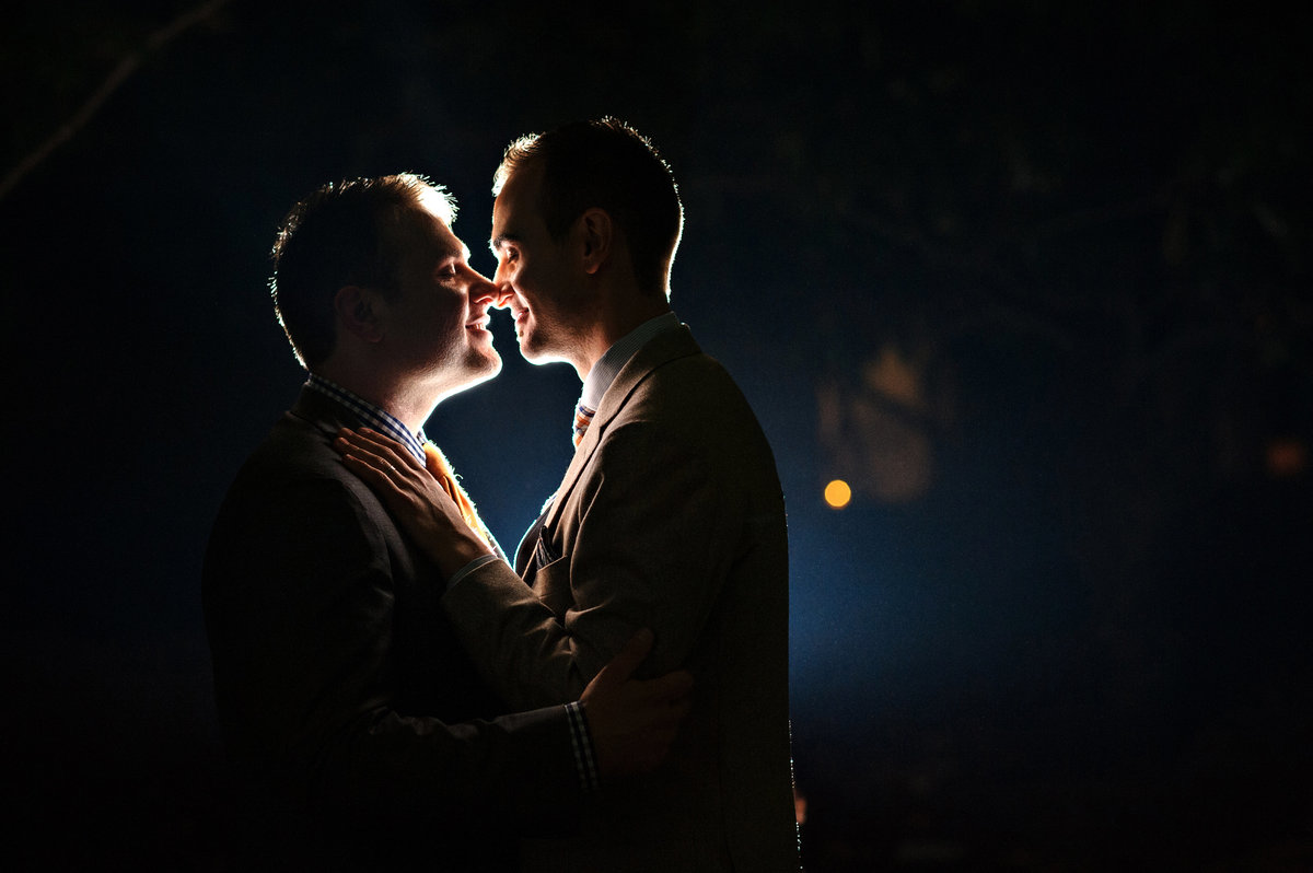 Two grooms share a kiss after their wedding at the patapsco female institute.