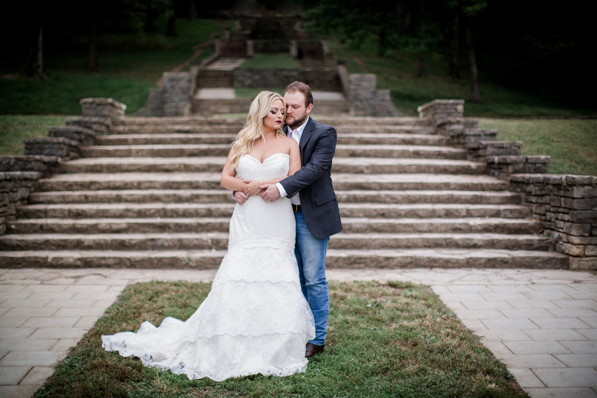 Bride and groom standing in front of stairs at Percy Warner Park in Nashville, TN by Knoxville Wedding Photographer, Amanda May Photos.