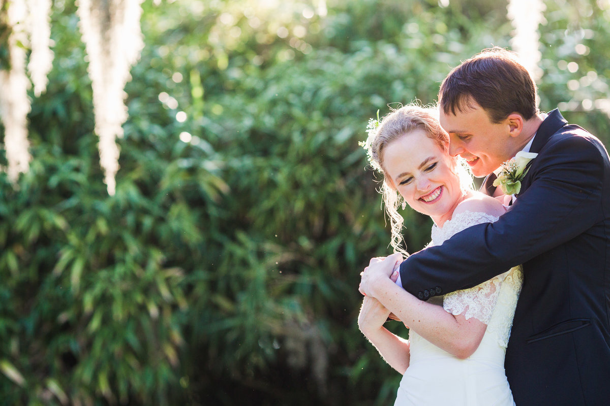 Laughing couple under spanish moss on Jekyll Island