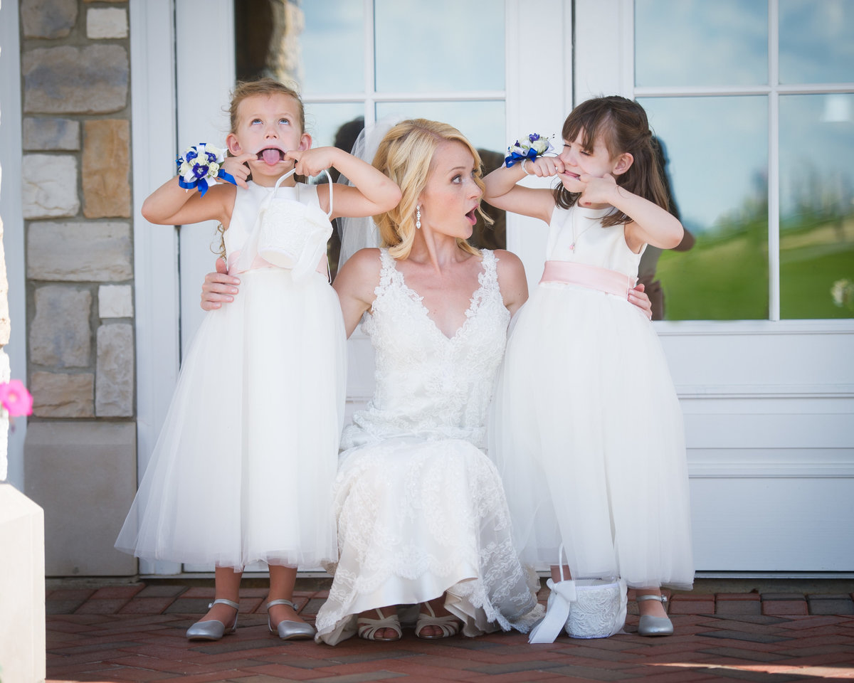 Flower girls make funny faces with bride, Chicago IL.