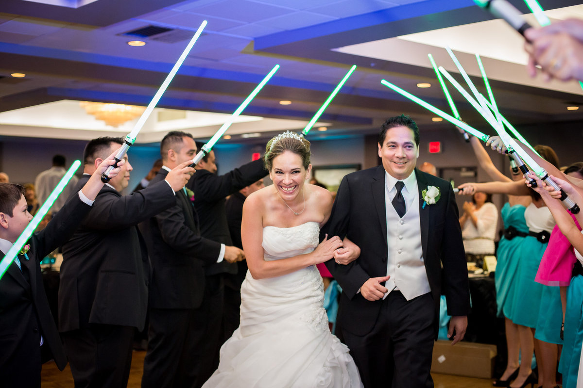 Bride and Groom reception light saber grand exit of star wars themed wedding at Holy Spirit Catholic Church venue
