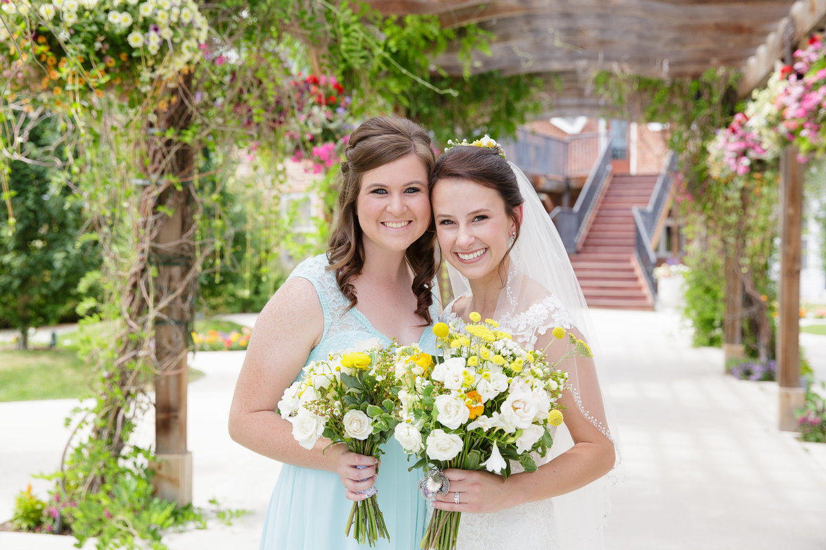 bride-with-bridesmaid-Colorado-garden-wedding