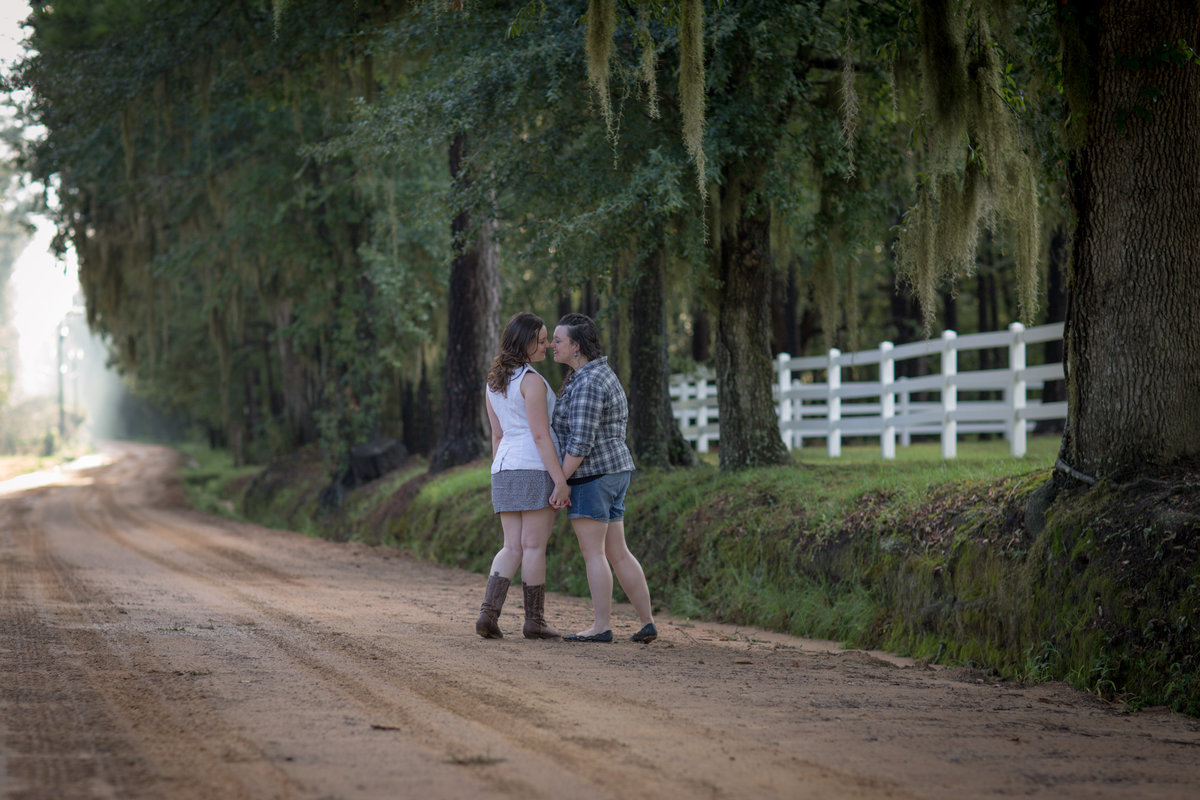 couple kissing on dirt road