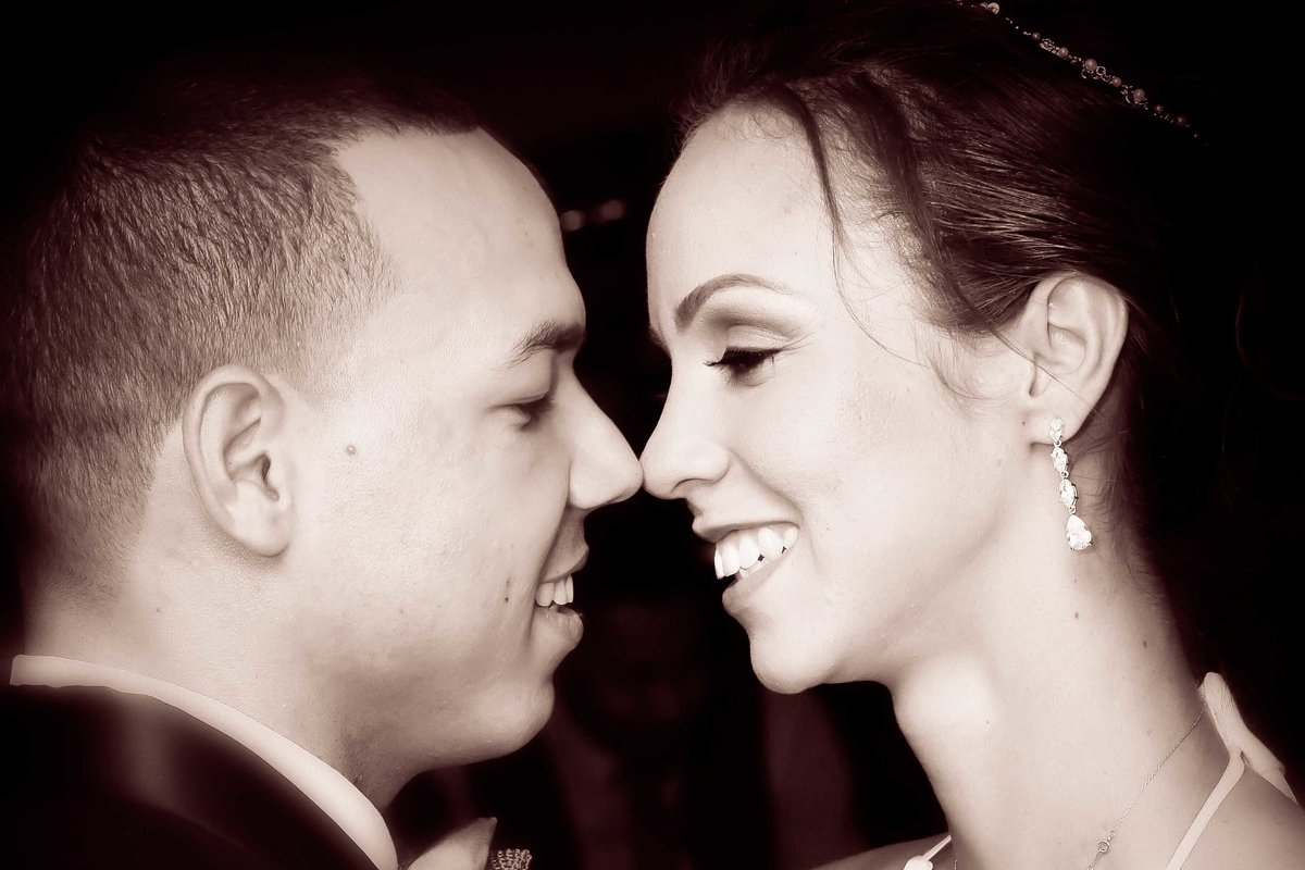 Bride and groom smile at each other in B+W. Photo by Ross Photography, Trinidad, W.I..