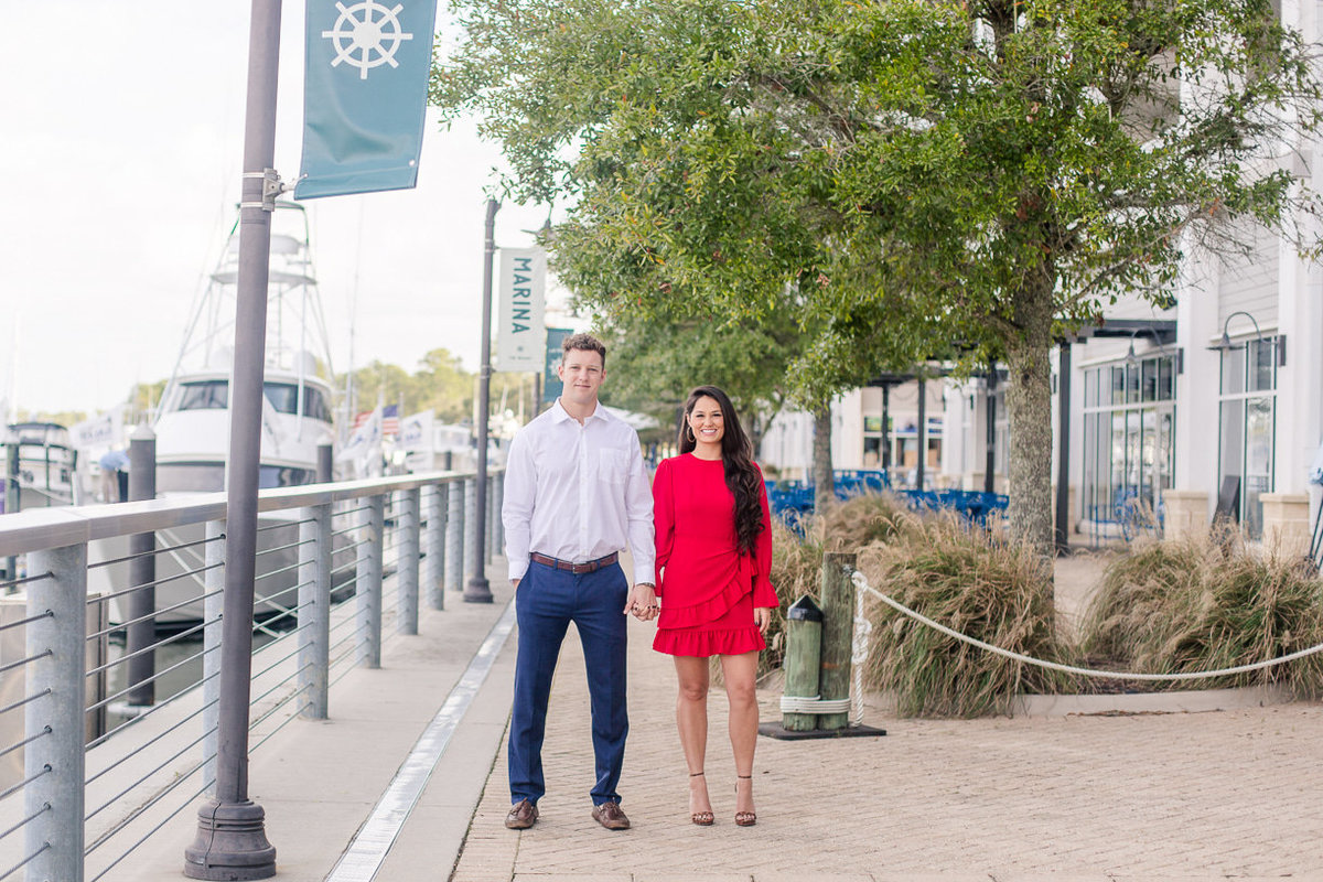 engagement session at the wharf in orange beach photographed by toni goodie photography