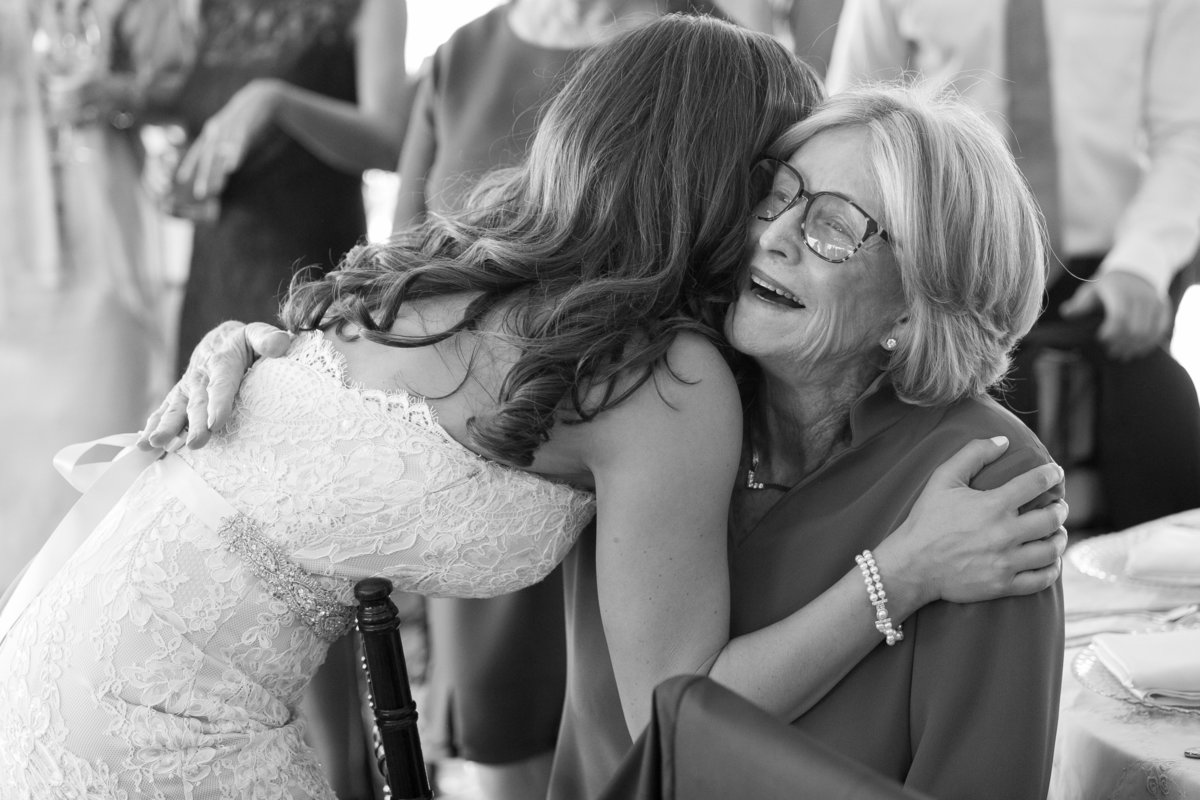 bride hugging grandma on her wedding day