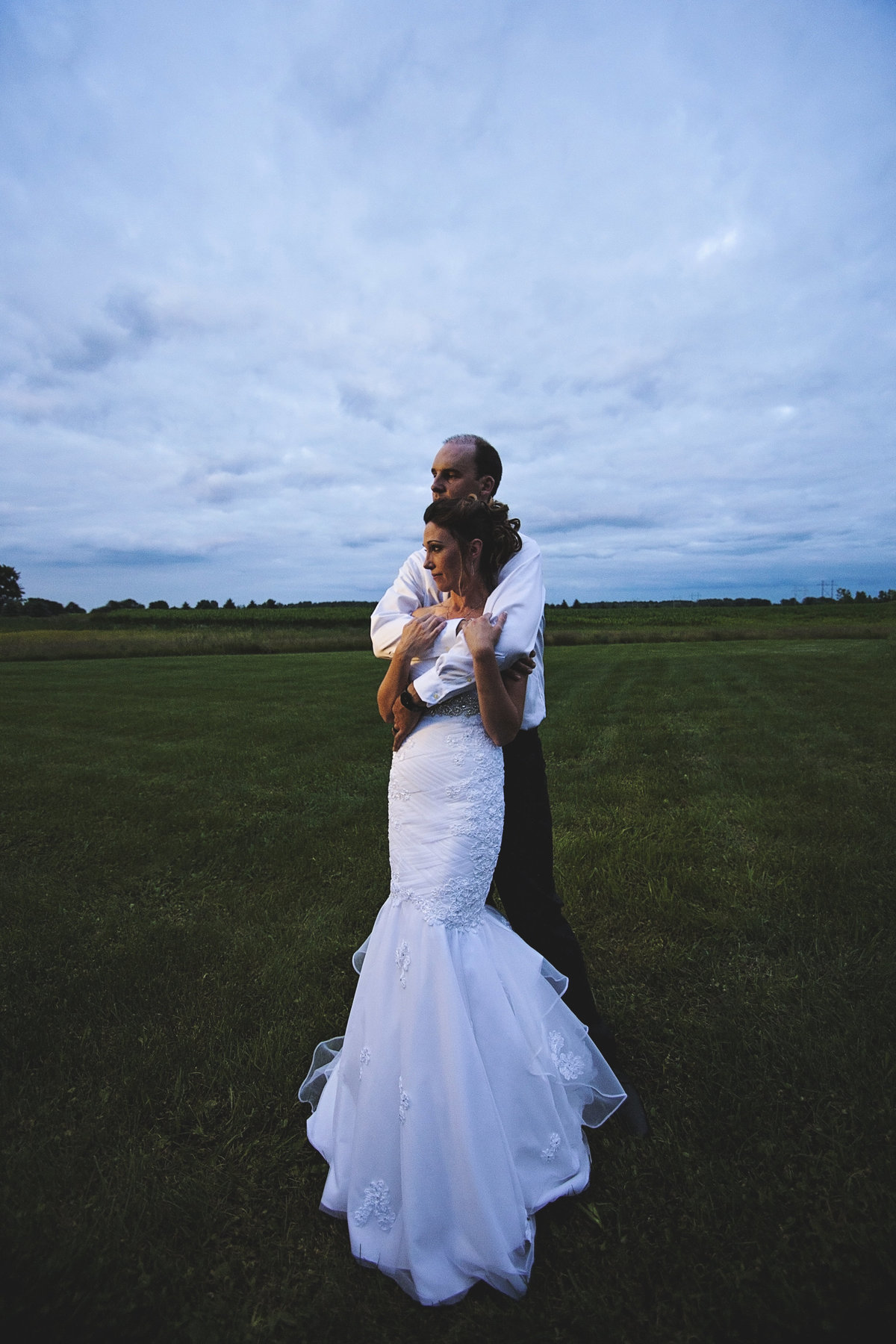 Bride and groom posing at sunset rustic chic wedding at Simply Country Barn by Casi Lea Photography-green bay wedding photographer-door county wedding photographer-milwaukee wedding photographer-appleton wedding photographer-wisconsin weddings