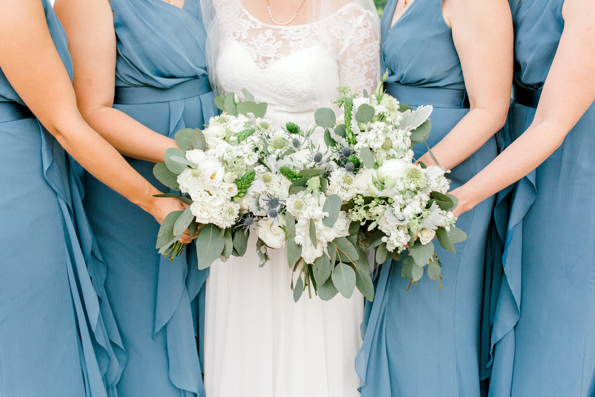 Bridesmaids holding flowers at Dayblock Event Center Wedding in Downtown Minneapolis Photographer