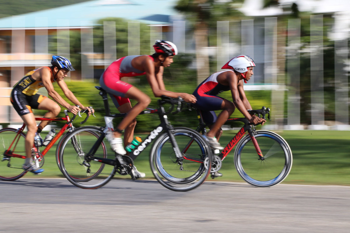 Image of three cyclists racing during a triathalon. Photo by Ross Photography, Trinidad, W.I..