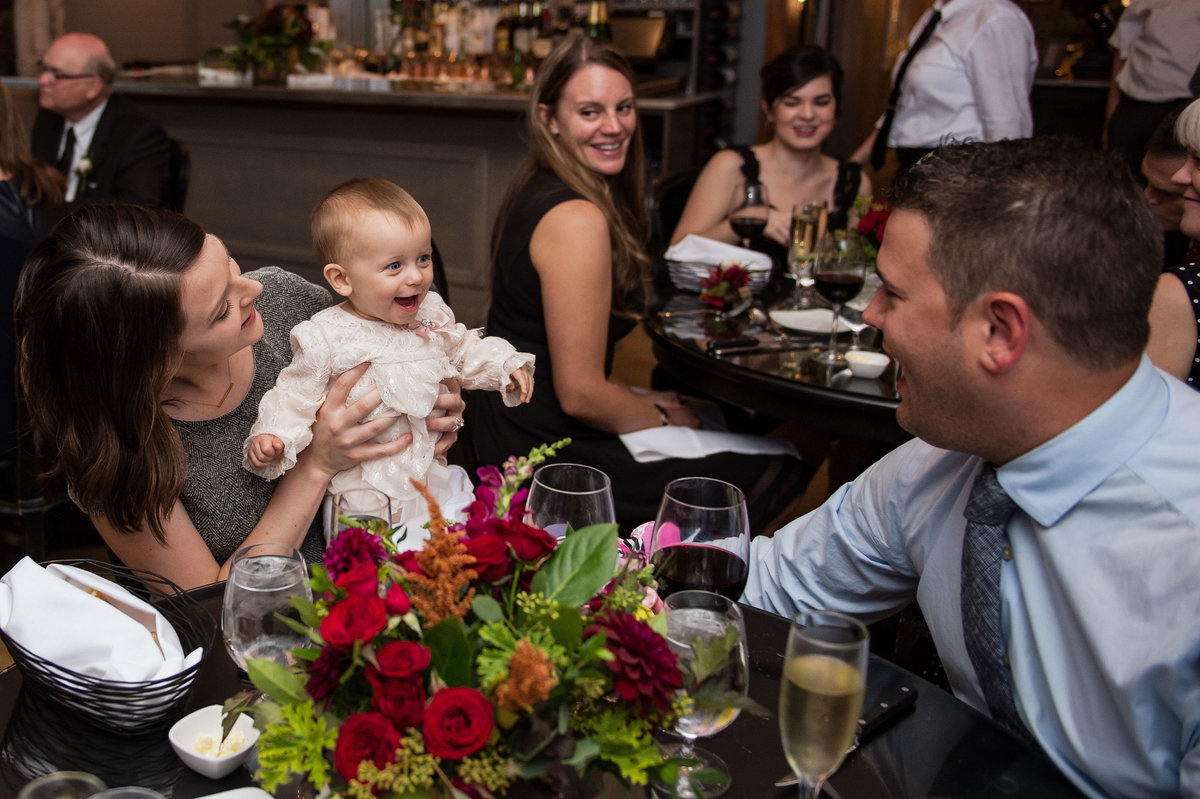 baby girl beams at daddy during reception