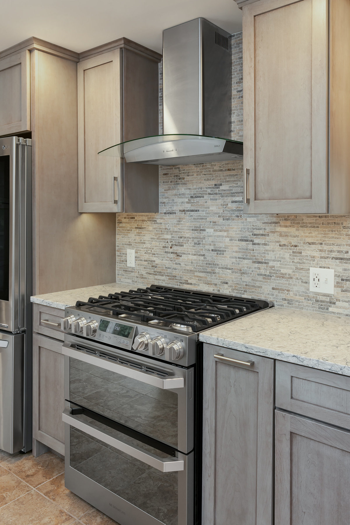 gas range - stone tile - quartz - gray kitchen