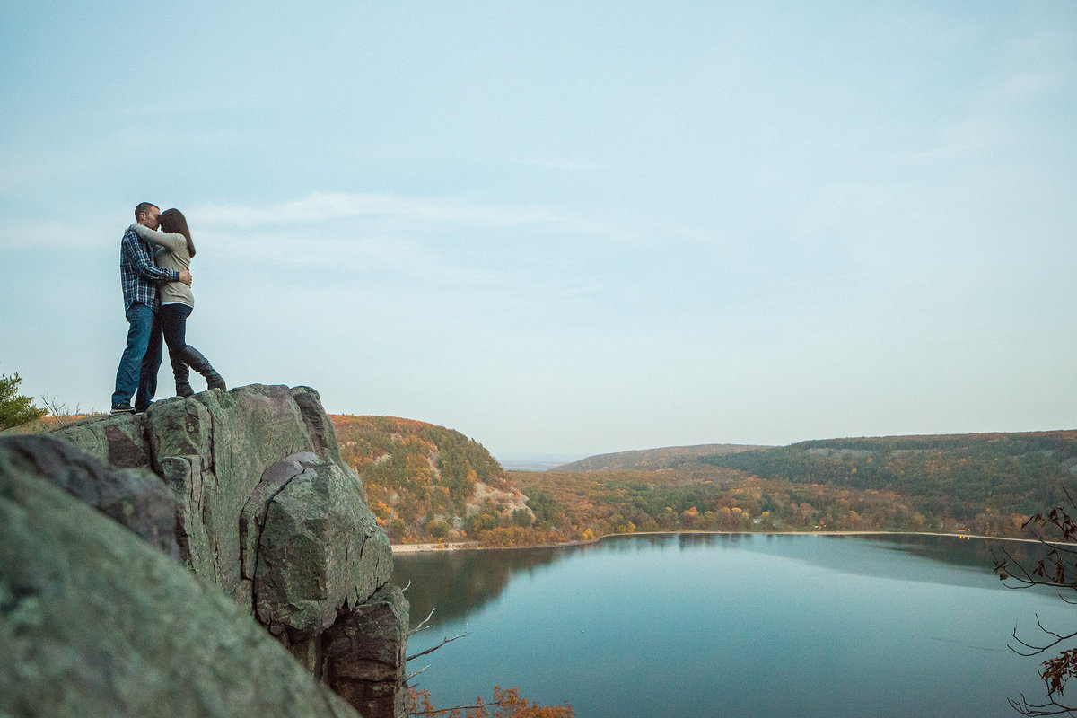 couple embracing while overlooking devils lake state park in wisconsin