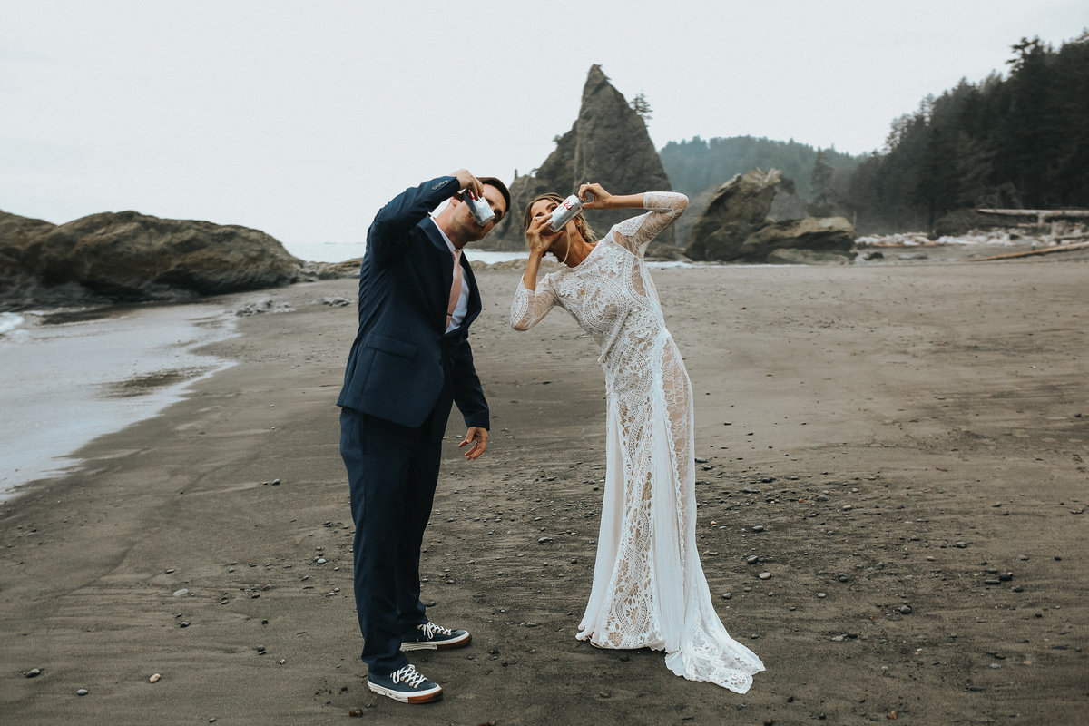 Bride and groom shotgun beer during their elopement at Rialto Beach in La Push Washington