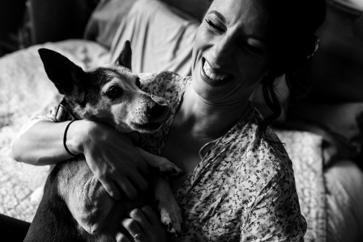 Newmarket New Hampshire Elopement Photographer the bride and her pup get in close for a kiss the morning of her wedding