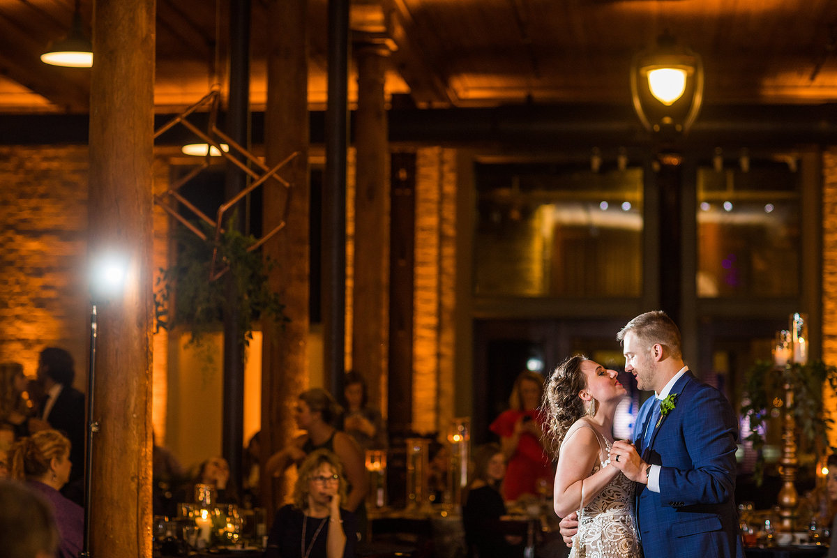 bride and groom having their first dance toughter after getting married at the pritzlaff in milwaukee wisconsin