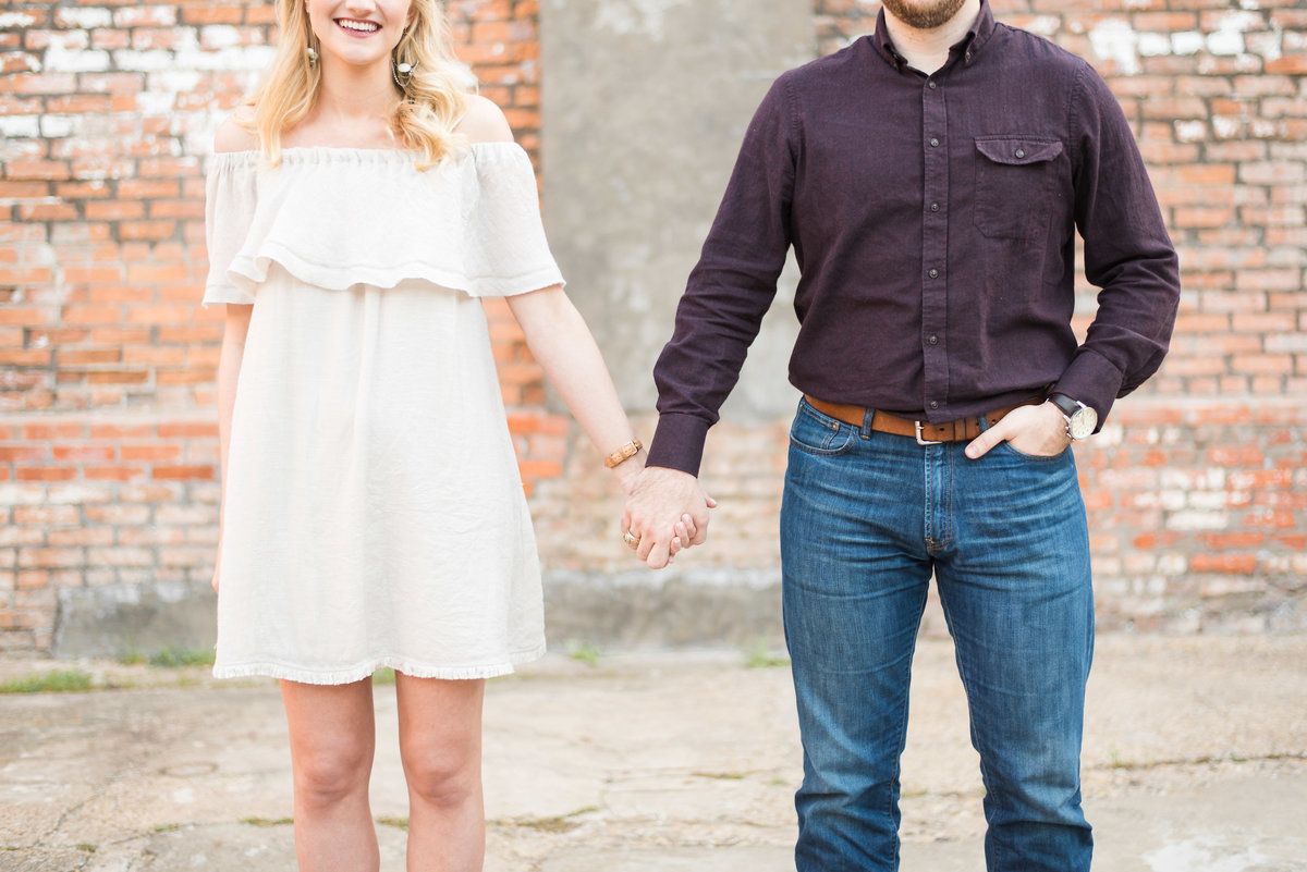 mckinney cotton mill engagement couple holding hands