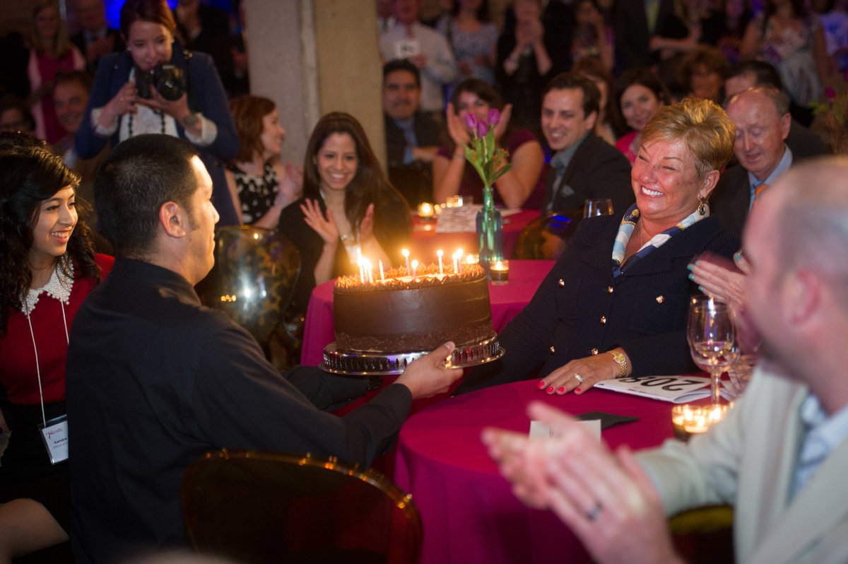 Guest honored with Birthday cake at Chicago fundraising event.