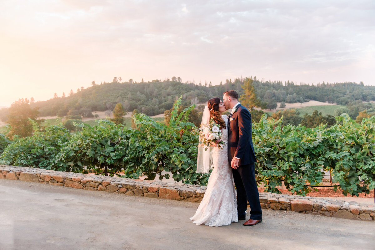 beautiful sunset behind bride and groom