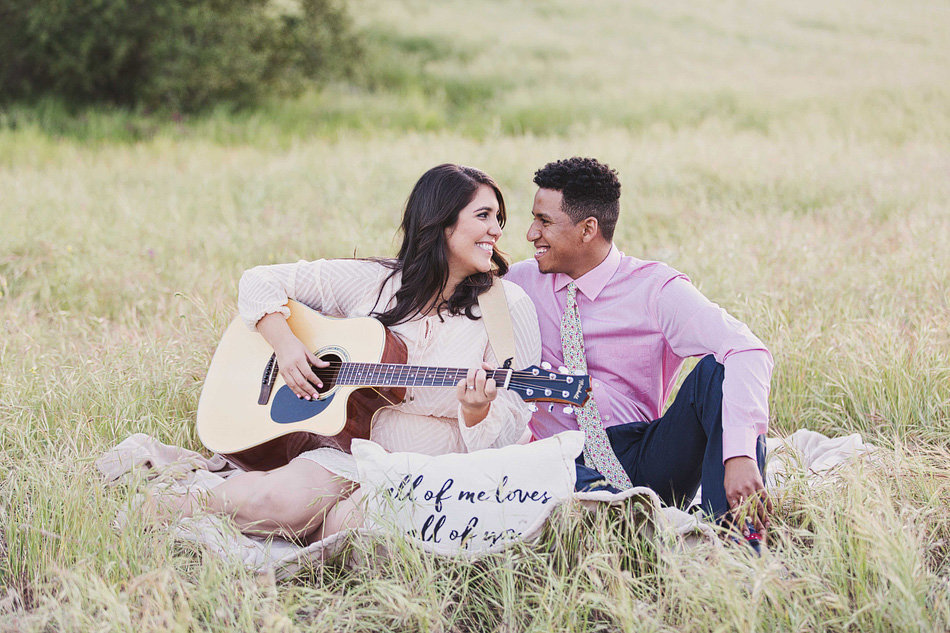 picnic styled engagement photos with a guitar