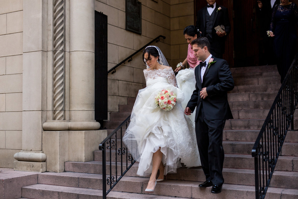 wedding couple exiting St Mary's Catholic Church in downtown San Antonio