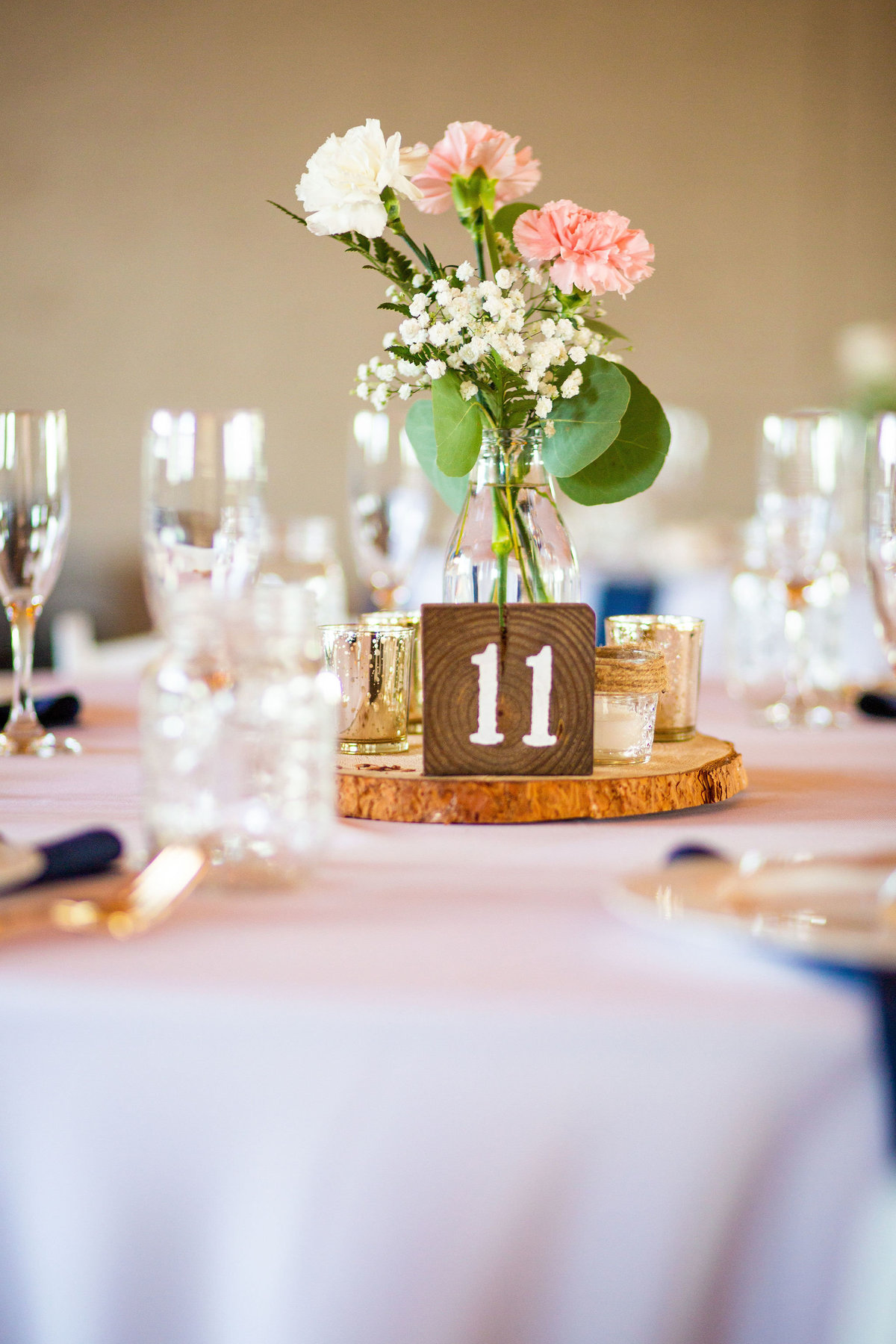 Strawberry-Creek-Ranch-Wedding-Ashley-McKenzie-Photography-Summer-love-on-the-ranch-Table-centerpieces