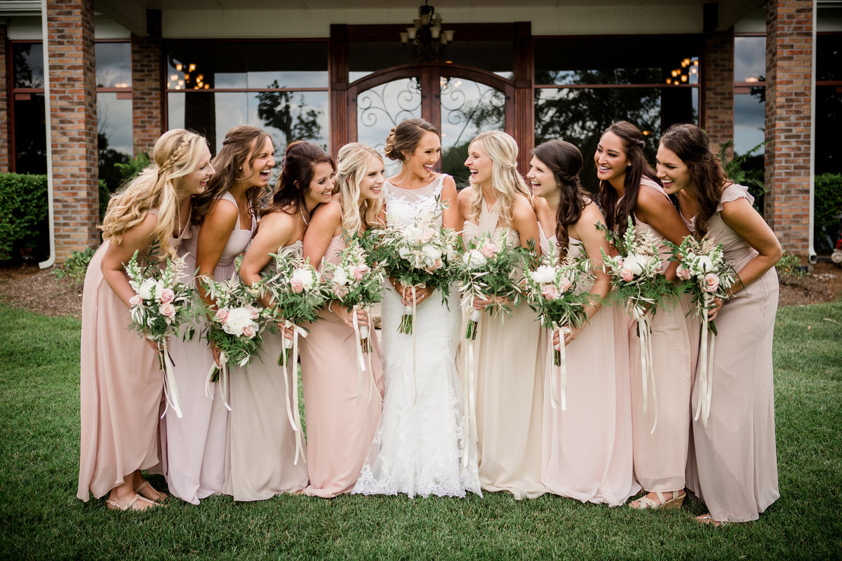 Bride and bridesmaids huddled together at Hunter Valley Farm Wedding Venue by Knoxville Wedding Photographer, Amanda May Photos.
