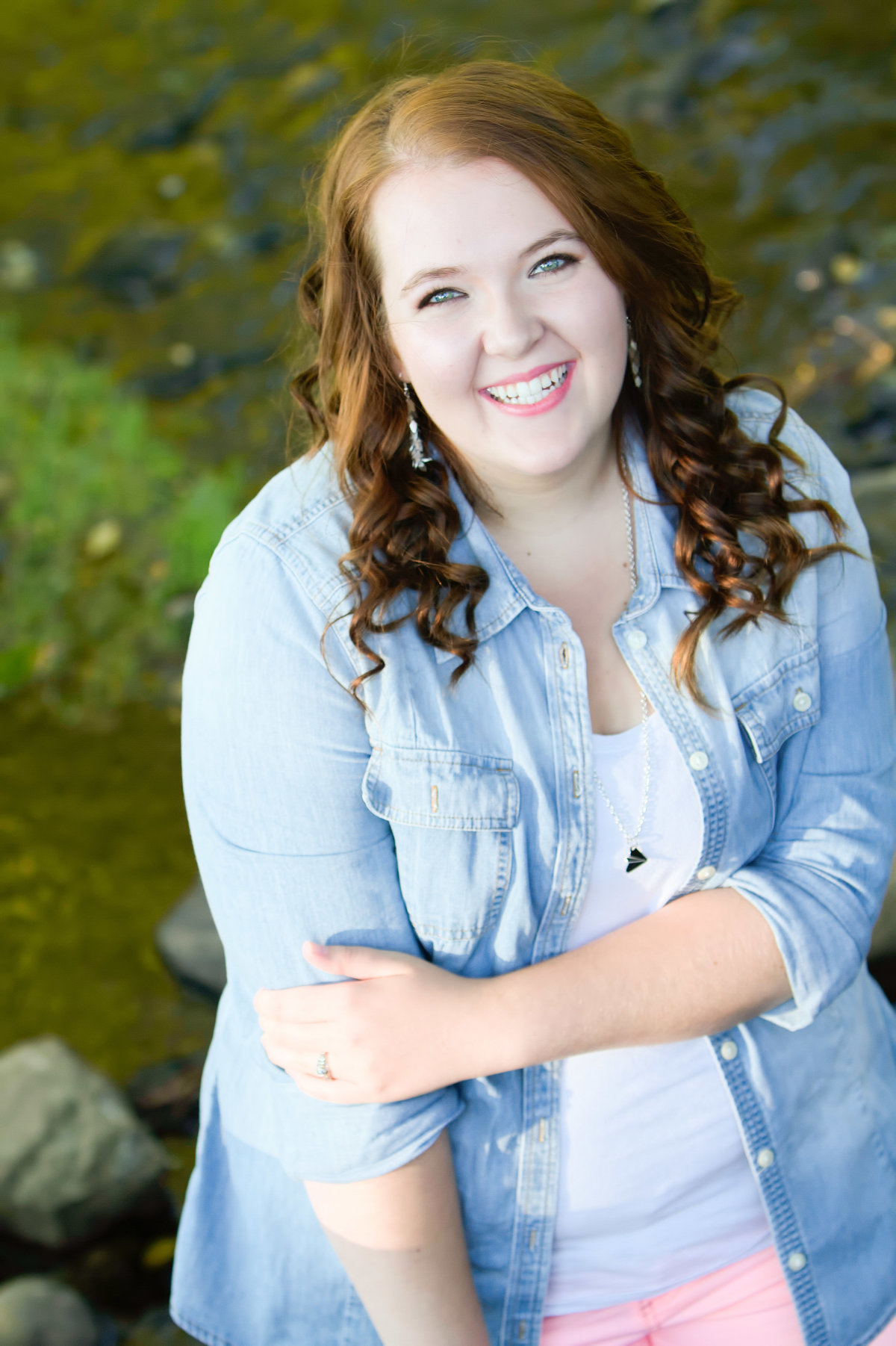 Girl Senior portrait by creek