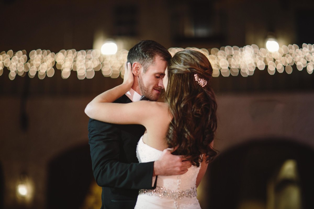 Bride and groom dance at Roof Top ballroom wedding
