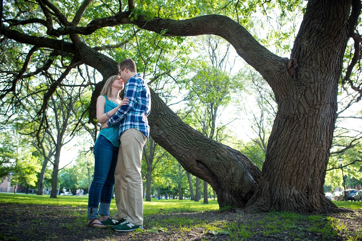 Couple poses under tree, Palmer Square Park, Chicago IL.