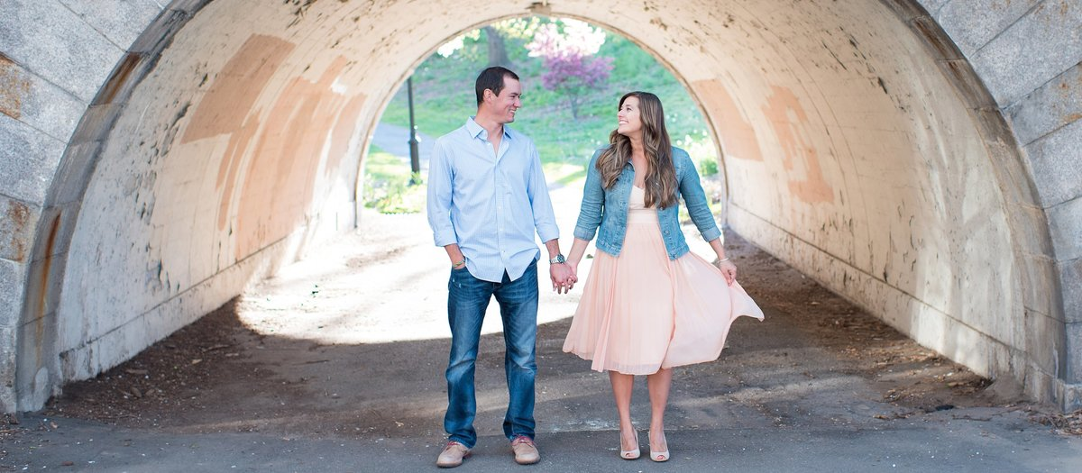 Couple Walking under tunnel in Hudson River Greenway in New York City Image photo