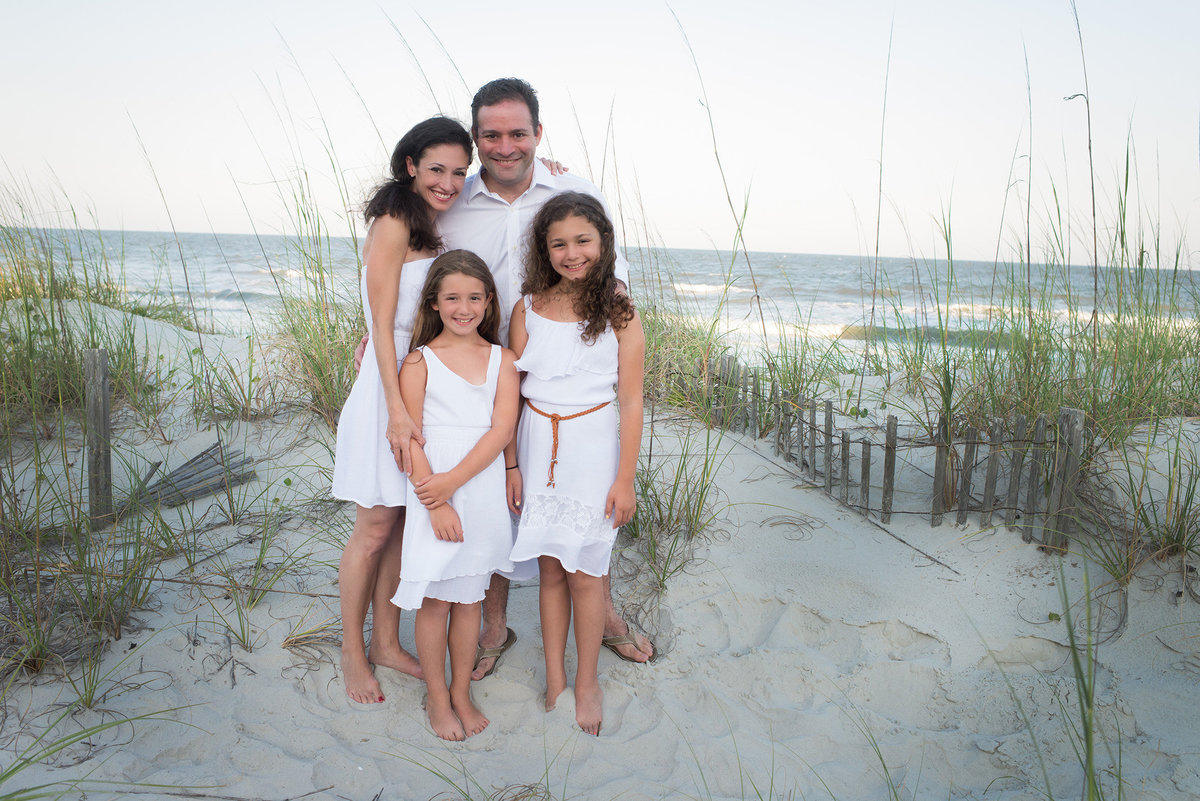 a family in white at the beach