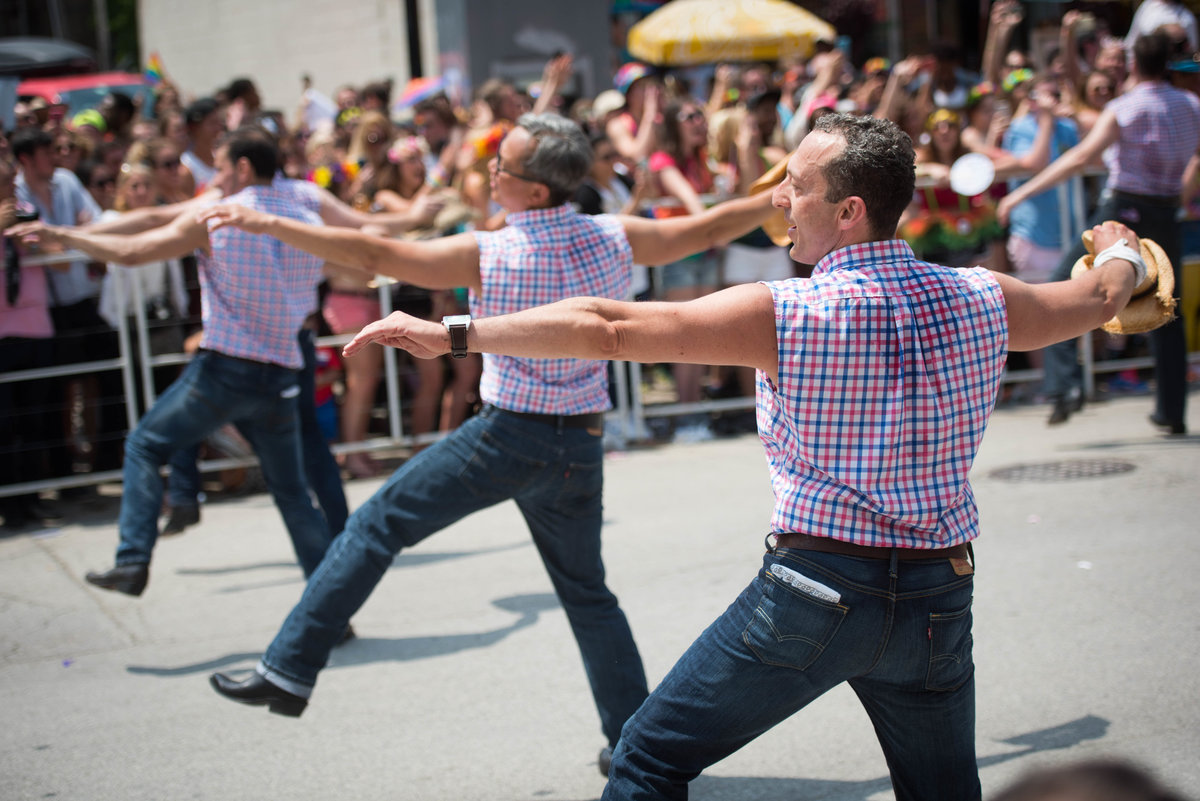 Men dance at Chicago pride parade 2015.
