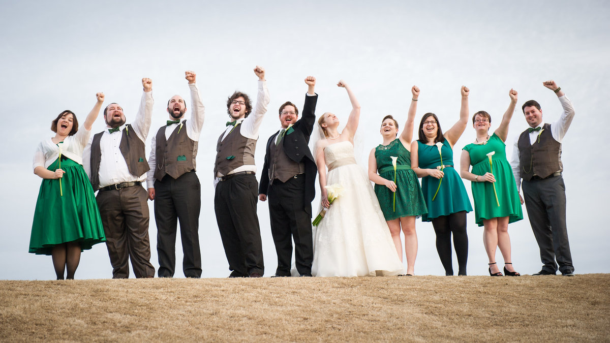 Atlanta Georgia, bridal party cheers on hilltop.