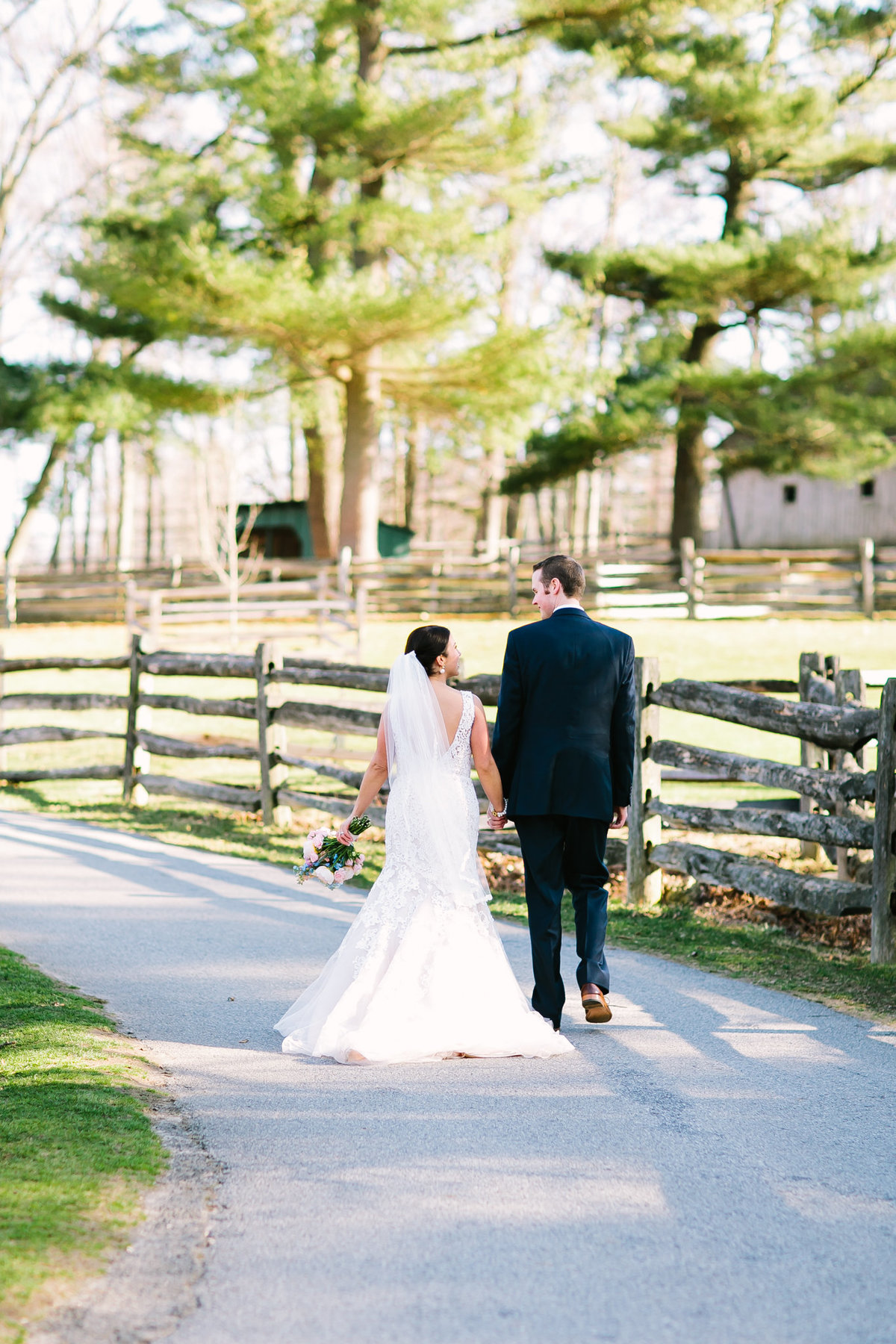 bride and groom walking at the stamford museum and nature center