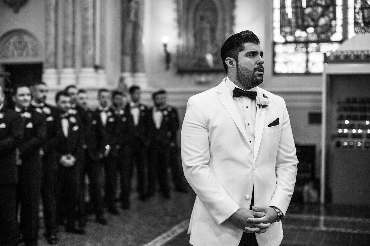grooms reaction to seeing his bride at saint peters cathedral in rockford illinois