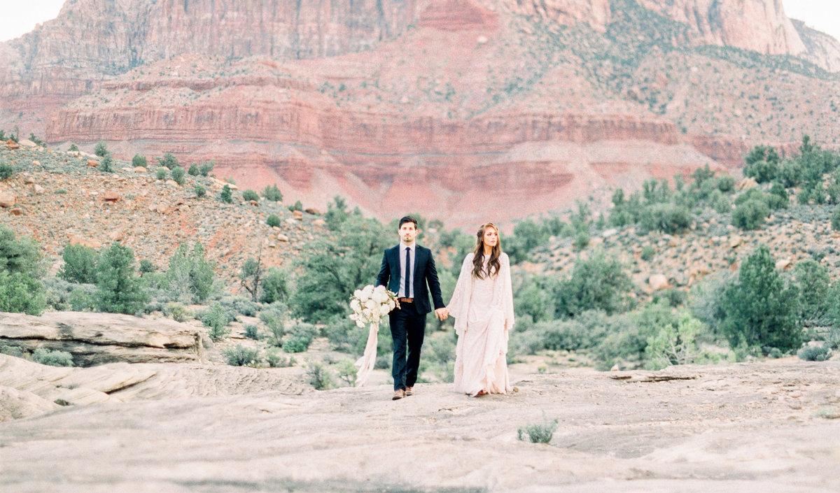 Intimate elopement on red rocks in Zion National Park