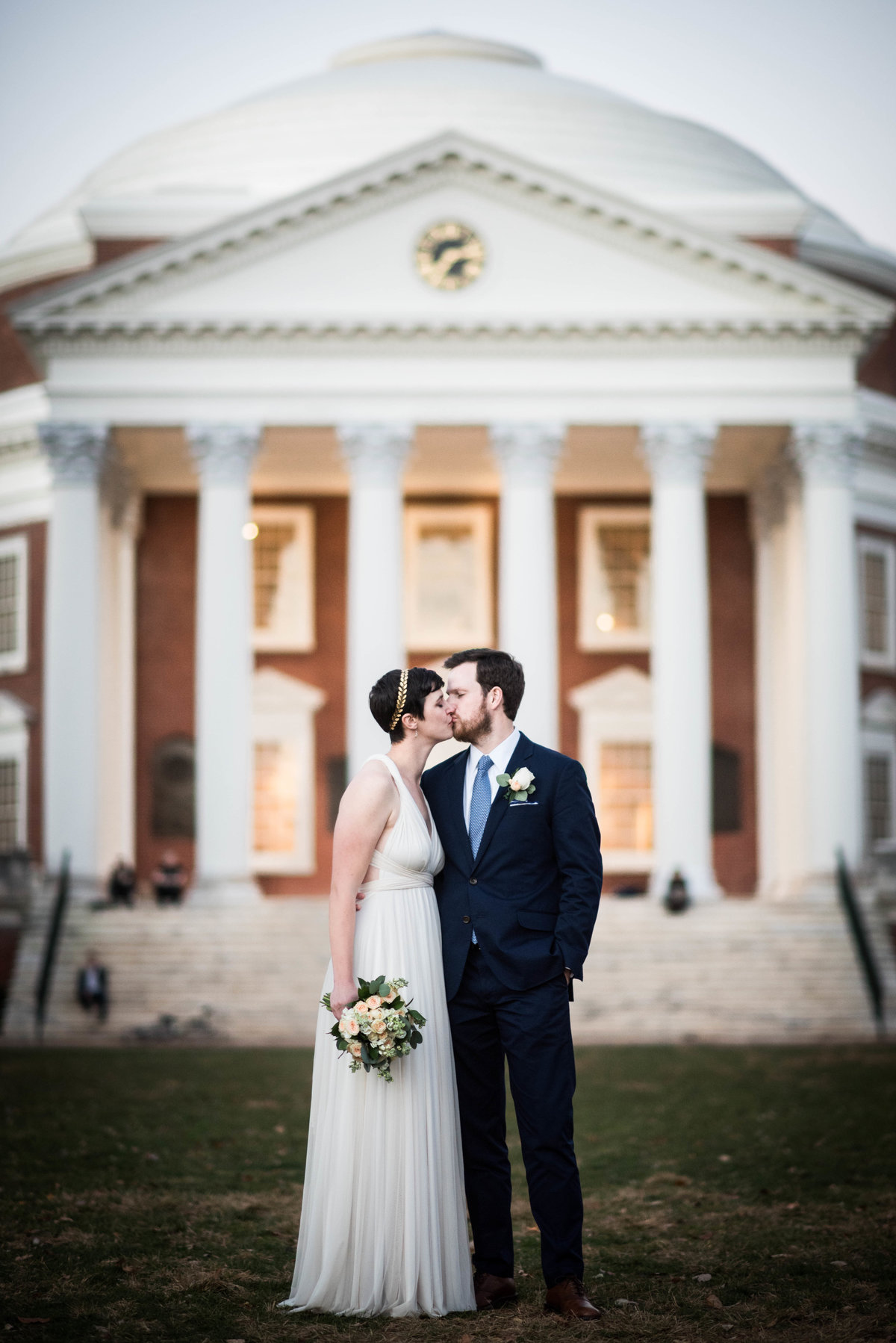 Bride and groom kiss on campus quad, Charlottesville VA.
