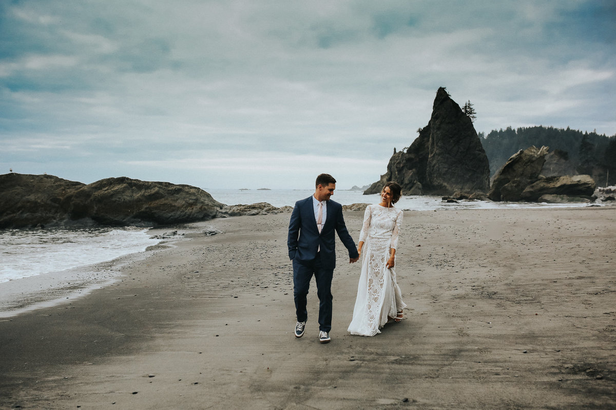 Bride and groom portrait of an elopement wedding in Forks Washington on the moody beaches of Rialto Beach.
