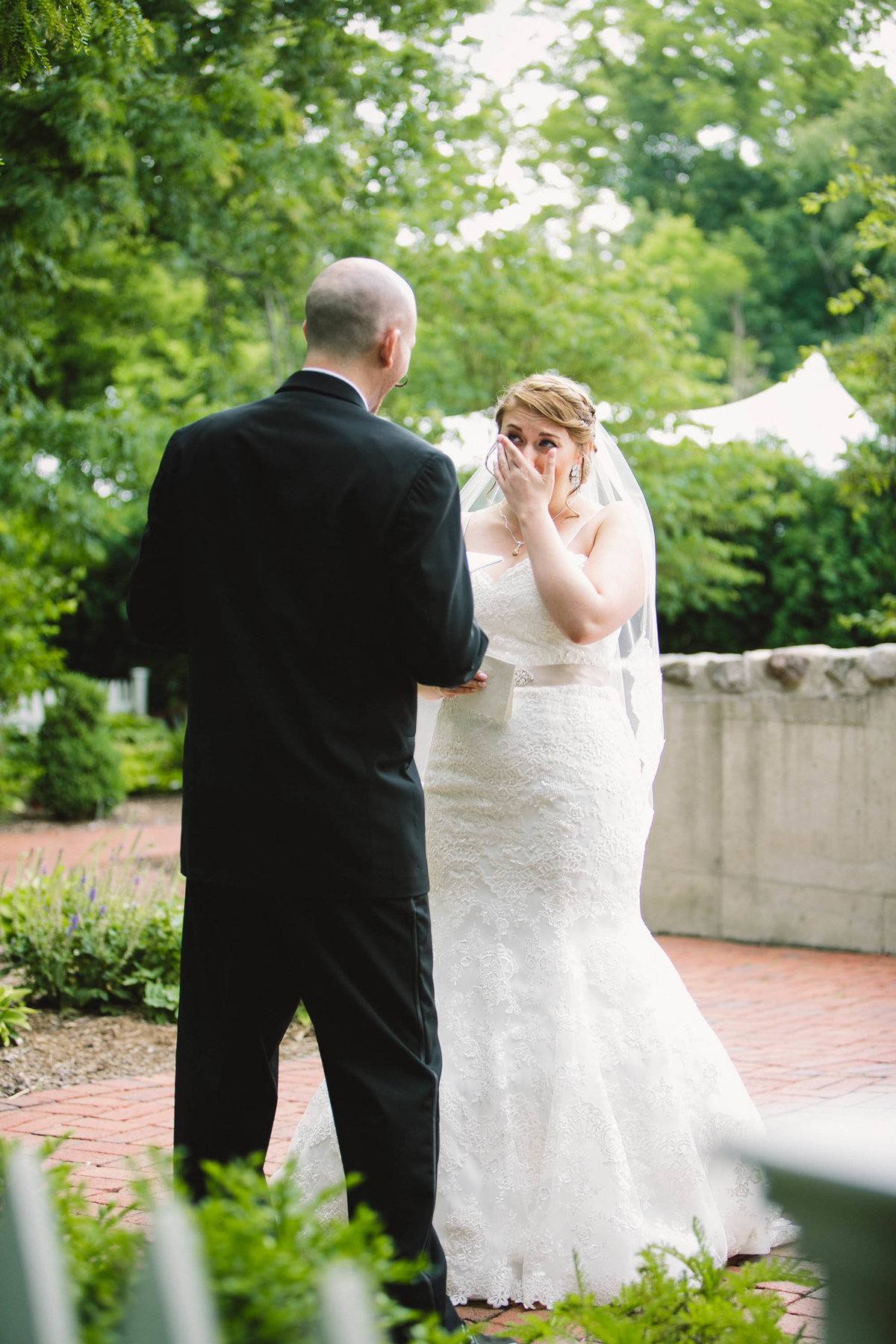 Bride cries when she sees groom for the first time at Ambassador House wedding in fishers