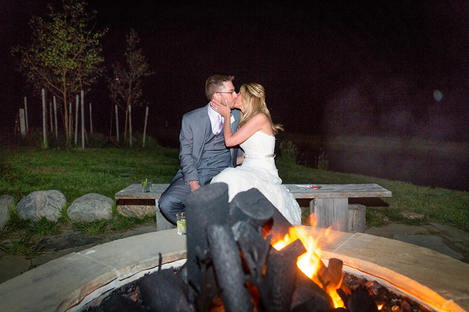 Strawberry-Creek-Ranch-Wedding-Ashley-McKenzie-Photography-Small-Wildflower-Outdoor-Wedding-Kissing-next-to-bonfire