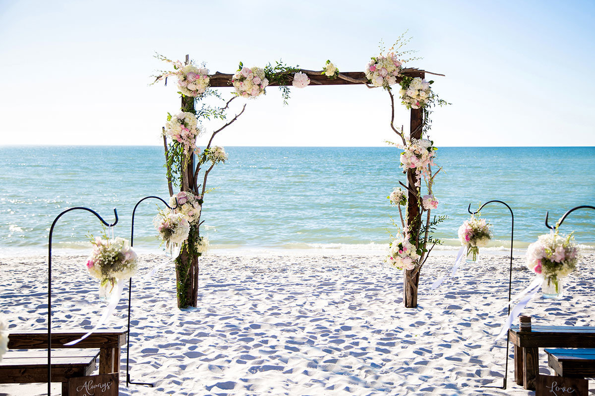ritz carlton naples florida wooden branches  wedding arch