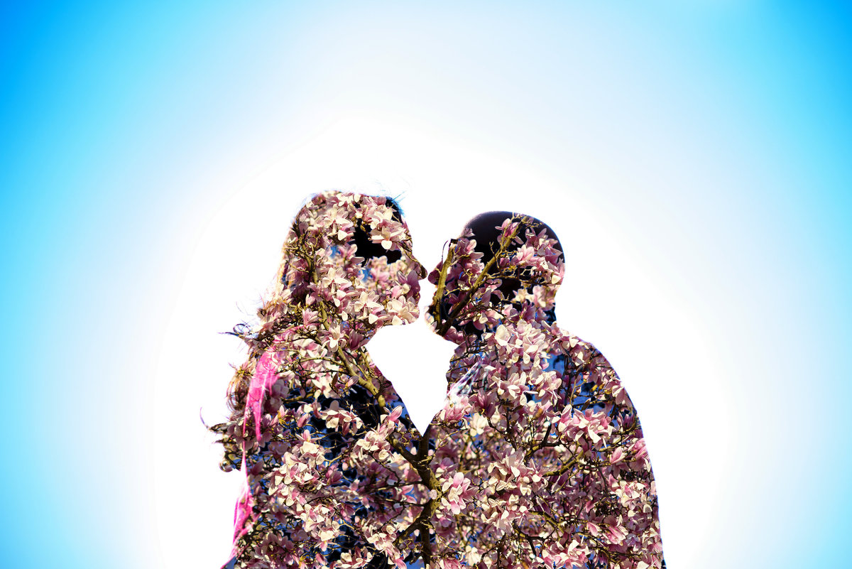 A double exposure of an engaged couple and beautiful blooming flowers.