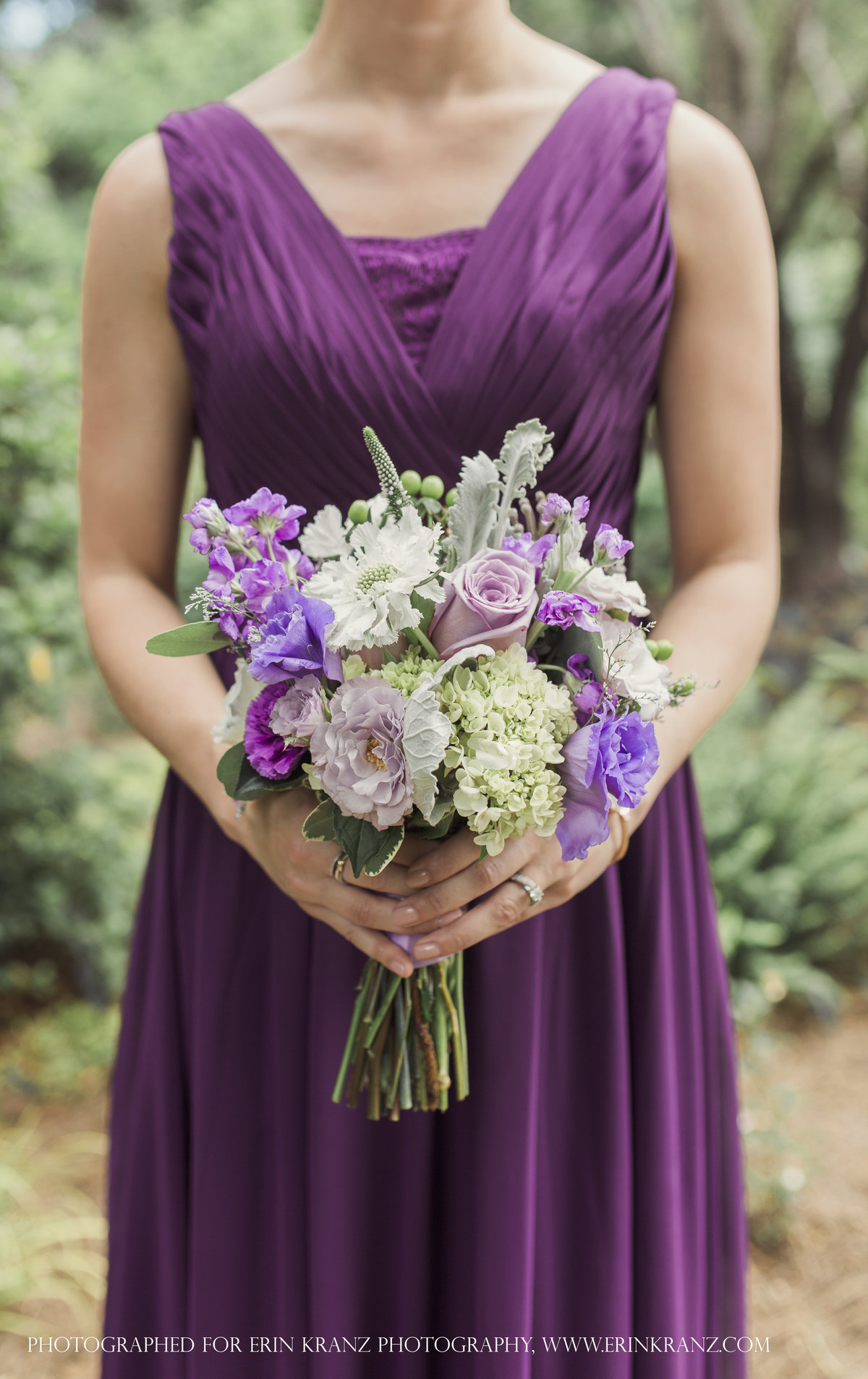 charlotte wedding photographer jamie lucido captures a bridal party detail of dress and bouquet featuring purple and white florals at Barclay Villa Raleigh
