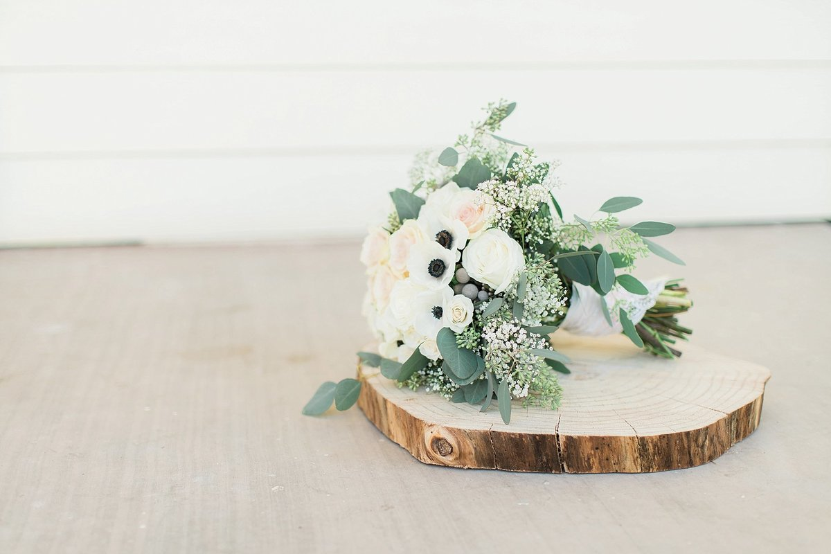 green and white bridal bouquet with anemone
