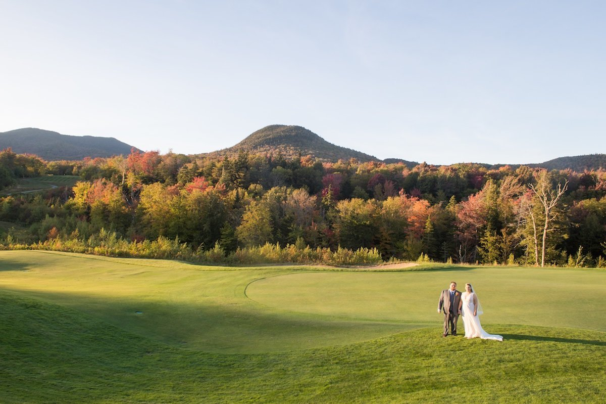 Outdoor mountain wedding ceremony at Jay Peak Resort during fall foliage season 1