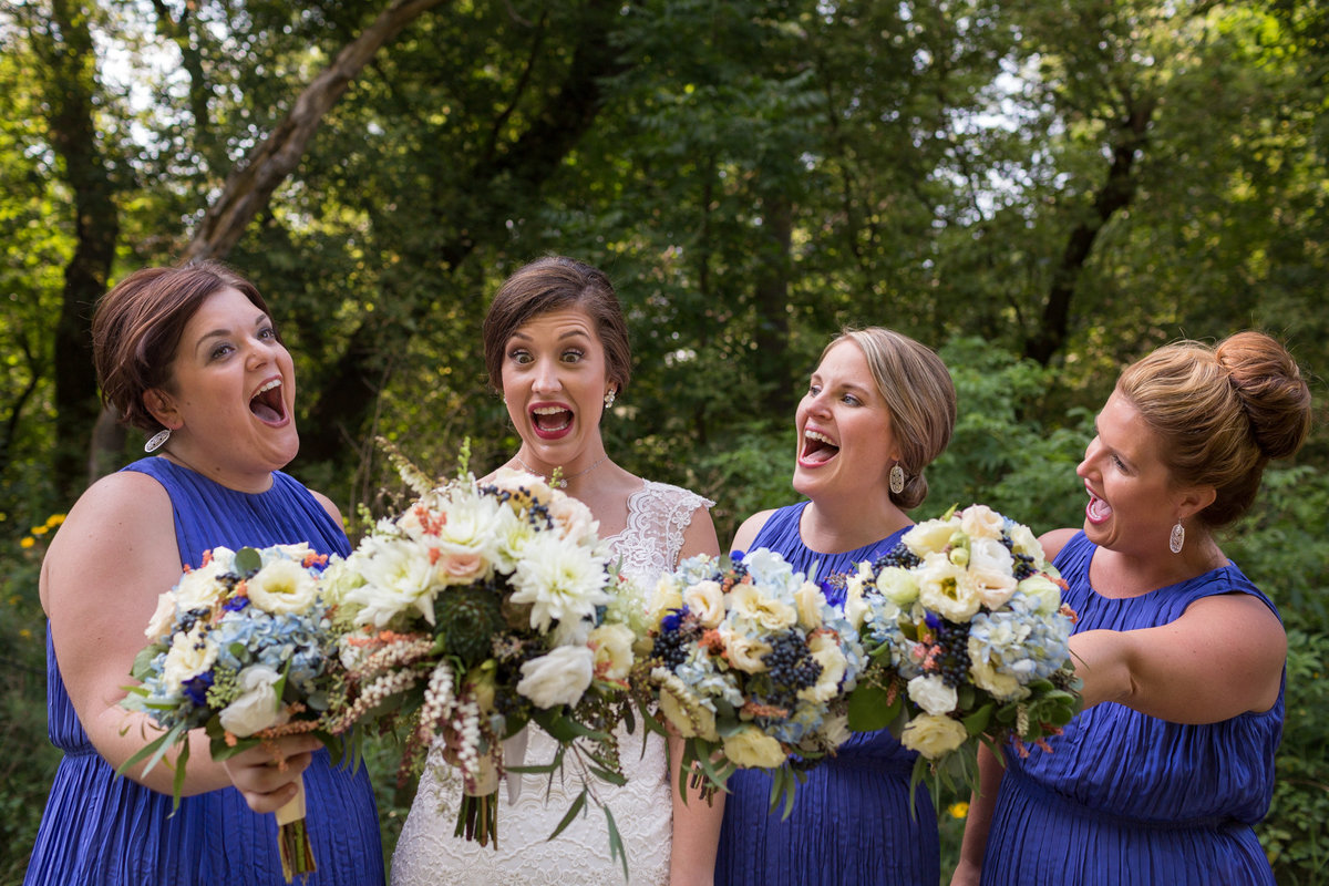 Wedding Photography - Bride and her bridesmaids nearly freak out over their bouquets at Quarry Hill Nature Center