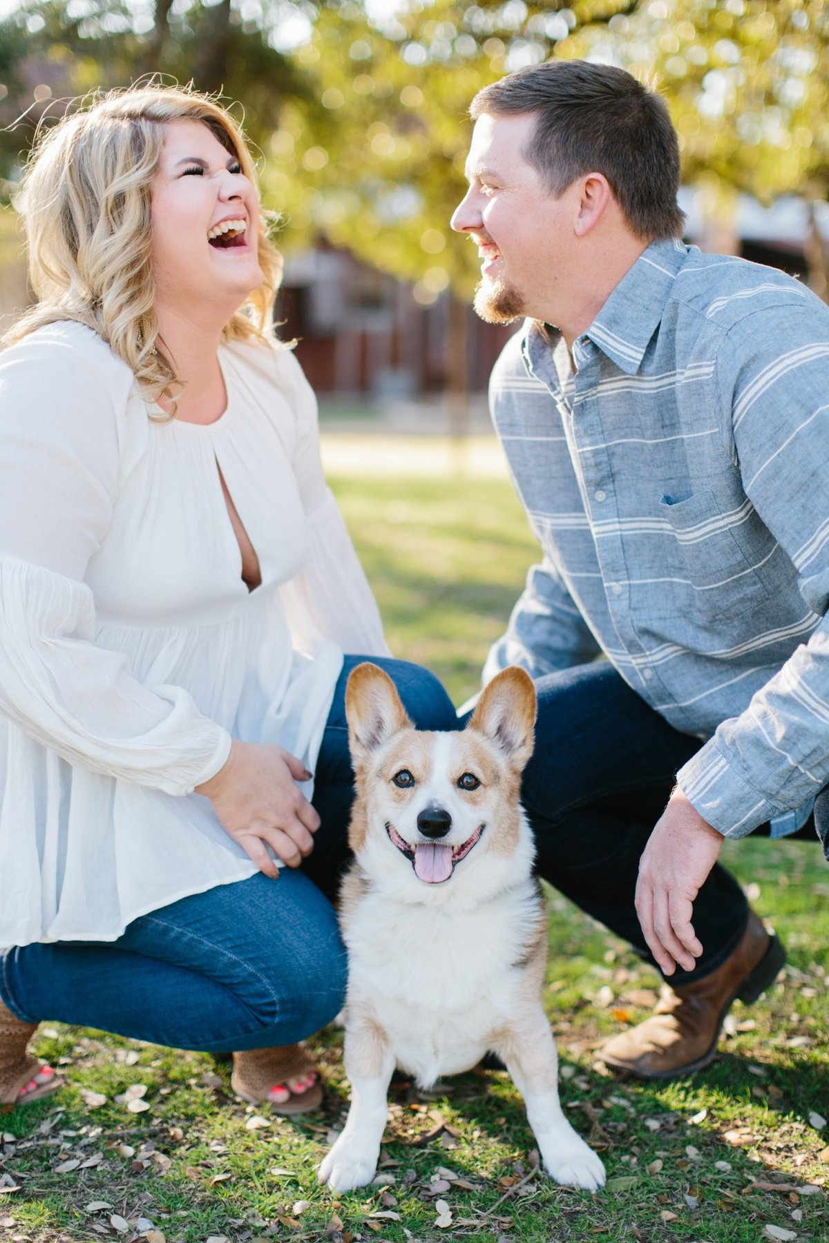 Film Engagement Session in Gruene, Texas. Bride wearing white flowy top, groom is wearing light blue button up. They brought their dog, a corgi to the session!